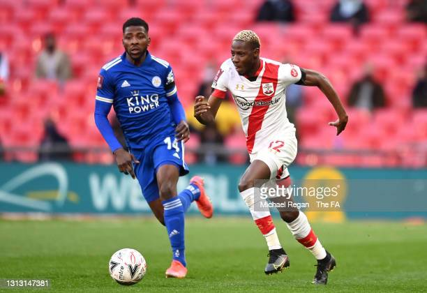 Moussa Djenepo of Southampton runs with the ball under pressure from Kelechi Iheanacho of Leicester City during the Semi Final of the Emirates FA Cup...