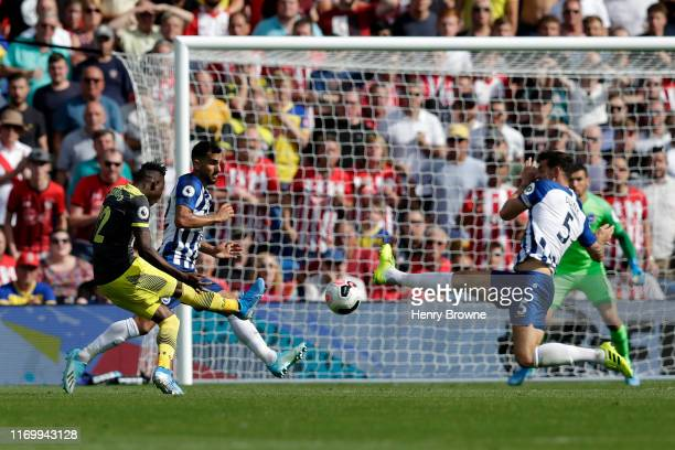 Moussa Djenepo of Southampton scores his team's first goal during the Premier League match between Brighton & Hove Albion and Southampton FC at...