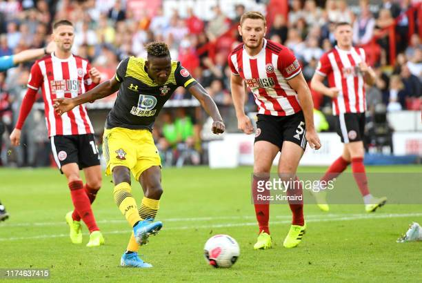 Moussa Djenepo of Southampton scores his team's first goal during the Premier League match between Sheffield United and Southampton FC at Bramall...