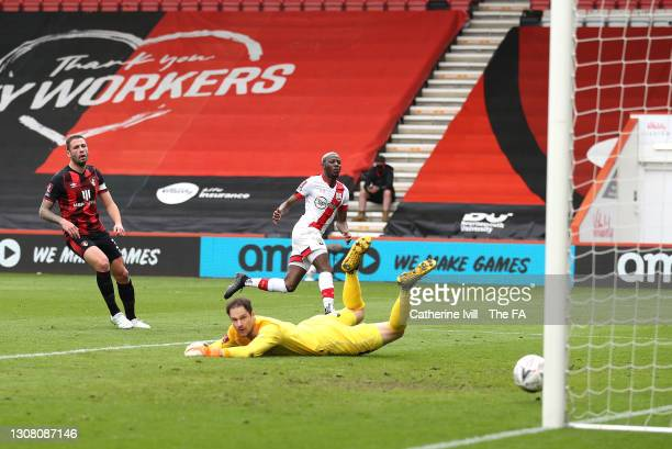 Moussa Djenepo of Southampton scores their team's first goal past Asmir Begovic of AFC Bournemouth during The Emirates FA Cup Quarter Final match...