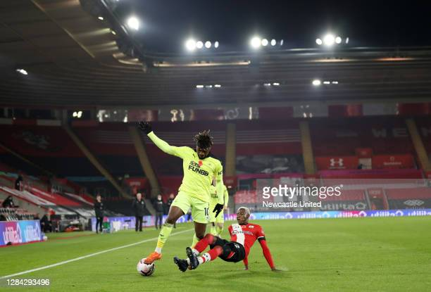Moussa Djenepo of Southampton tackles Allan Saint-Maximin of Newcastle United during the Premier League match between Southampton and Newcastle...