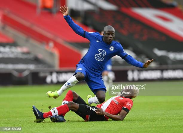 Moussa Djenepo of Southampton tackles N'Golo Kante of Chelsea during the Premier League match between Southampton and Chelsea at St Mary's Stadium on...
