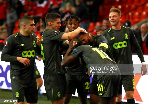 Moussa Djenepo of Standard Liege celebrates after scoring his team's first goal with his team mates during the UEFA Europa League Group J match...