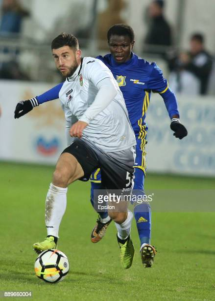 Moussa Doumbia of FC Rostov RostovonDon vies for the ball with Bojan Jokic of FC Ufa during the Russian Premier League match between FC Rostov...