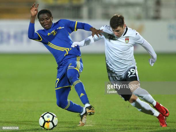 Moussa Doumbia of FC Rostov RostovonDon vies for the ball with Dmitry Stotsky of FC Ufa during the Russian Premier League match between FC Rostov...