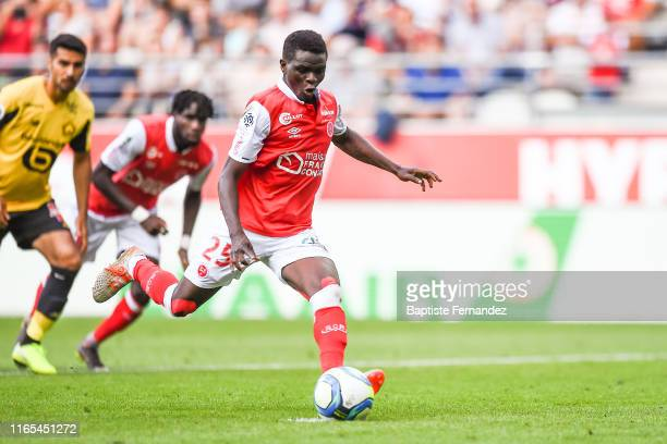 Moussa Doumbia of Reims scores his goal from the penalty spot during match between Stade de Reims and LOSC Lille on September 1, 2019 in Reims,...