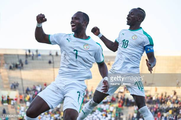 Moussa Konate and Sadio Mane celebrate after scoring the victory goal during a friendly match between Senegal and Mali after both teams qualified for...