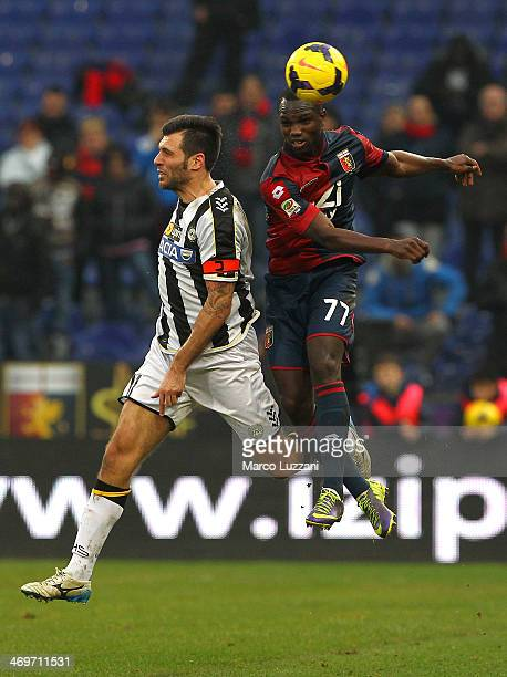 Moussa Konate of Genoa CFC competes for the ball with Maurizio Domizzi of Udinese Calcio during the Serie A match between Genoa CFC and Udinese...