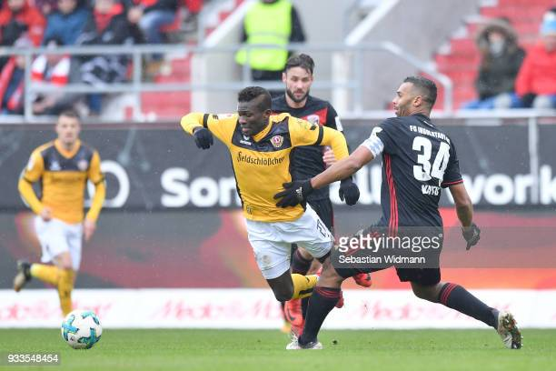 Moussa Kone of Dresden and Marvin Matip of Ingolstadt compete for the ball during the Second Bundesliga match between FC Ingolstadt 04 and SG Dynamo...
