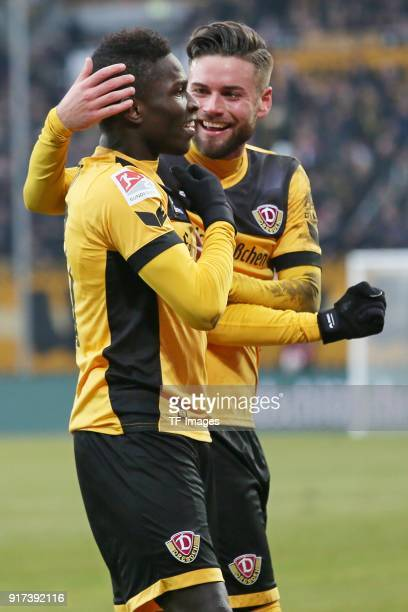Moussa Kone of Dresden celebrates after scoring his team`s second goal with a team mate during the Second Bundesliga match between SG Dynamo Dresden...