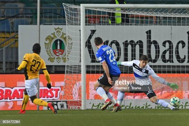 Moussa Kone of Dresden scores against Florian Dick and Stefan Ortega Moreno of Bielefeld during the Second Bundesliga match between DSC Arminia...