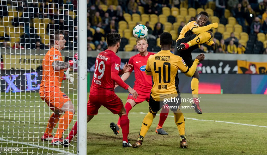 Moussa Kone (R) of Dresden scores his team's first goal past goalkeeper Kevin Mueller of Heidenheim during the Second Bundesliga match between SG Dynamo Dresden and 1. FC Heidenheim 1846 at DDV-Stadion on March 9, 2018 in Dresden, Germany.
