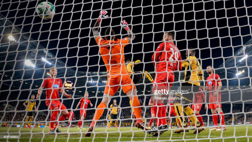 Moussa Kone (C) of Dresden scores his team's first goal past goalkeeper Kevin Mueller of Heidenheim during the Second Bundesliga match between SG Dynamo Dresden and 1. FC Heidenheim 1846 at DDV-Stadion on March 9, 2018 in Dresden, Germany.