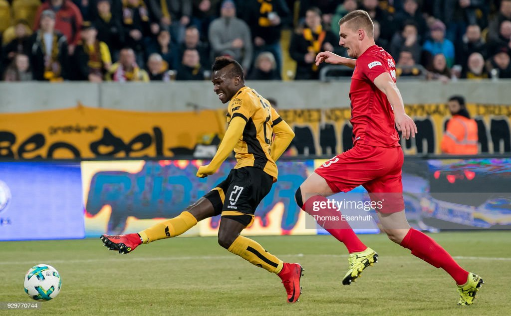 Moussa Kone (L) of Dresden scores his team's second goal past Kevin Kraus of Heidenheim during the Second Bundesliga match between SG Dynamo Dresden and 1. FC Heidenheim 1846 at DDV-Stadion on March 9, 2018 in Dresden, Germany.