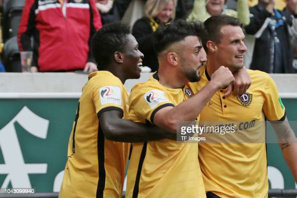 Moussa Kone of Dynamo Dresden Aias Aosman of Dynamo Dresden and Philip Heise of Dynamo Dresden celebrate a goal during the Second Bundesliga match...