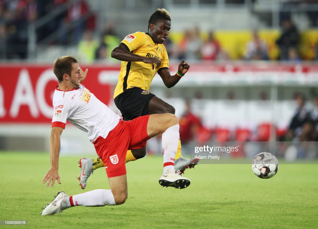 Moussa Kone of Dynamo Dresden is challenged by Andreas Geipl of Jahn Regensburg during the Second Bundesliga match between SSV Jahn Regensburg and SG Dynamo Dresden at Continental Arena on September 14, 2018 in Regensburg, Germany.