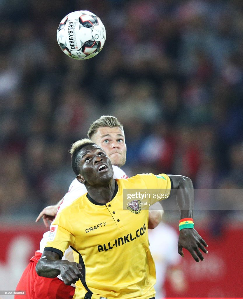 Moussa Kone of Dynamo Dresden is challenged by Benedikt Saller of Jahn Regensburg during the Second Bundesliga match between SSV Jahn Regensburg and SG Dynamo Dresden at Continental Arena on September 14, 2018 in Regensburg, Germany.