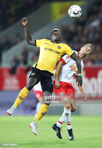 Moussa Kone of Dynamo Dresden is challenged by Benedikt Saller of Jahn Regensburg during the Second Bundesliga match between SSV Jahn Regensburg and...