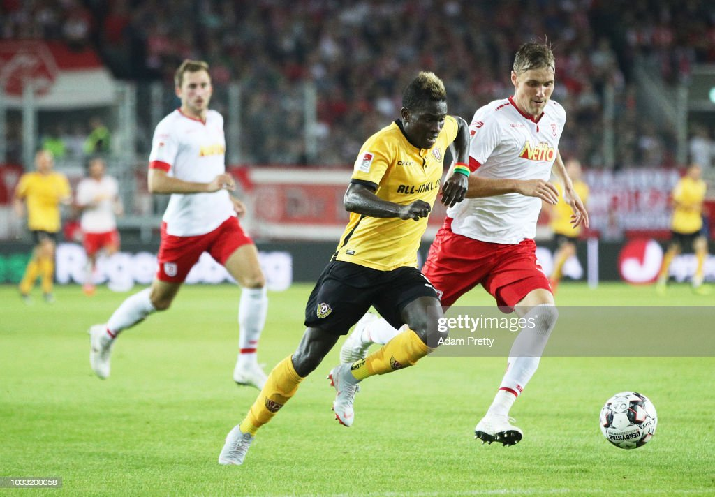 Moussa Kone of Dynamo Dresden is challenged by Jonas Foehrenbach of Jahn Regensburg during the Second Bundesliga match between SSV Jahn Regensburg and SG Dynamo Dresden at Continental Arena on September 14, 2018 in Regensburg, Germany.