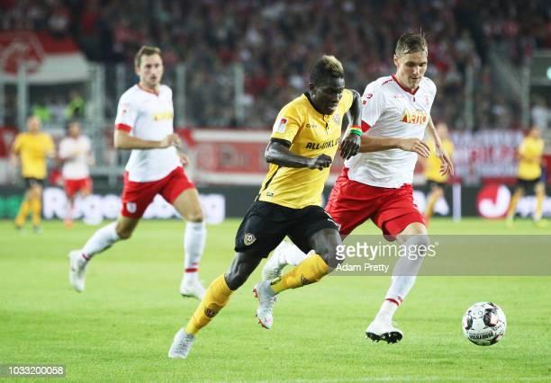 Moussa Kone of Dynamo Dresden is challenged by Jonas Foehrenbach of Jahn Regensburg during the Second Bundesliga match between SSV Jahn Regensburg...