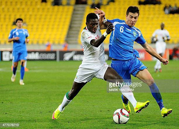 Moussa Kone of Senegal fights for the ball with Akramjon Komilov of Uzbekistan during the FIFA Under20 World Cup football quarterfinal match between...