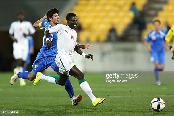 Moussa Kone of Senegal holds off the challenge of Javokhir Sokhibov of Uzbekistan during the FIFA U20 World Cup New Zealand 2015 quarterfinal match...