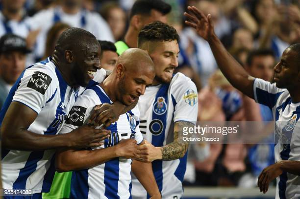 Moussa Marega celebrates with Yacine Brahimi of FC Porto after scores the second goal during the Primeira Liga match between FC Porto and Feirense at...