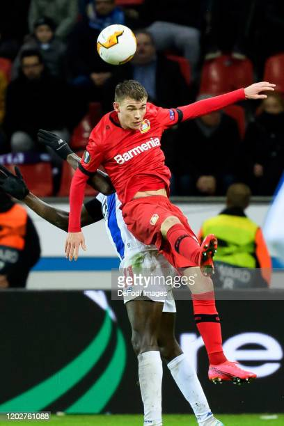 Moussa Marega of FC Porto and Daley Sinkgraven of Bayer 04 Leverkusen battle for the ball during the UEFA Europa League round of 32 first leg match...