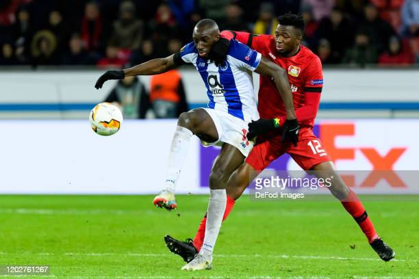 Moussa Marega of FC Porto and Edmond Tapsoba of Bayer 04 Leverkusen battle for the ball during the UEFA Europa League round of 32 first leg match...