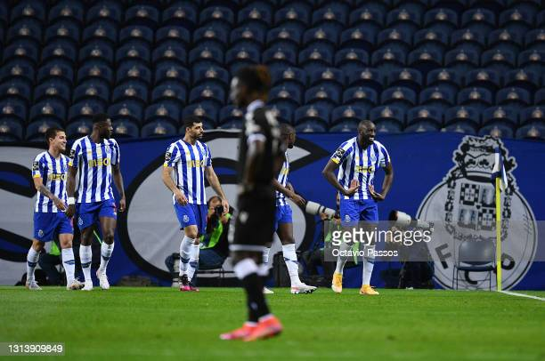 Moussa Marega of FC Porto celebrates with teammates after scores his sides first goal during the Liga NOS match between FC Porto and Vitoria...