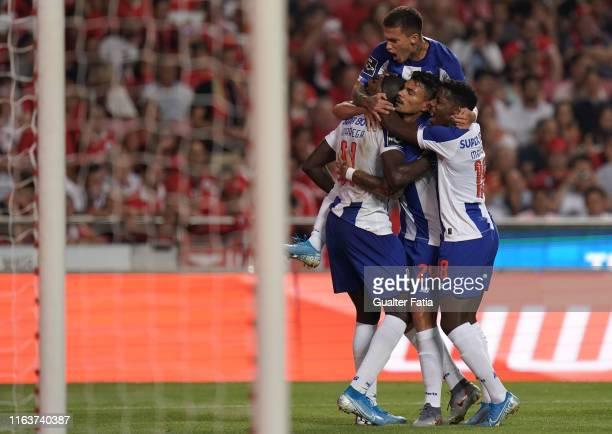 Moussa Marega of FC Porto celebrates with teammates after scoring a goal during the Liga NOS match between SL Benfica and FC Porto at Estadio da Luz...