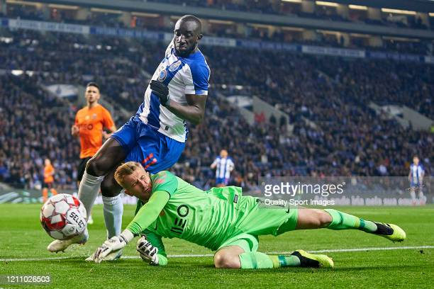 Moussa Marega of FC Porto competes for the ball with Pawel Kieszek of Rio Ave FC during the Liga Nos match between FC Porto and Rio Ave FC at Estadio...