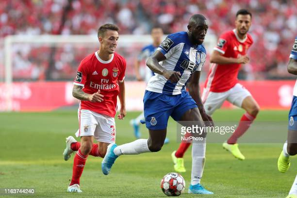 Moussa Marega of FC Porto vies with Alejandro Grimaldo of SL Benfica during the Portuguese League football match between SL Benfica and FC Porto at...