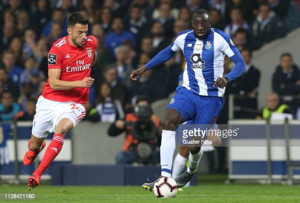 Moussa Marega of FC Porto with Andreas Samaris of SL Benfica in action during the Liga NOS match between FC Porto and SL Benfica at Estadio do Dragao...