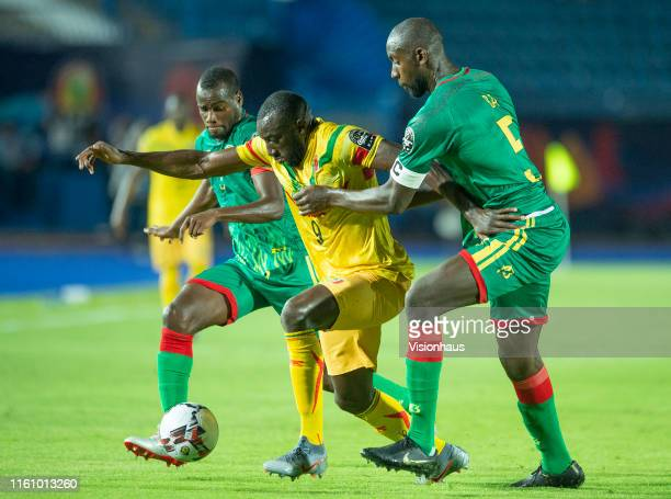 Moussa Marega of Mali and Aly Abeid and Ba Abdoul of Mauritania during the 2019 Africa Cup of Nations Group E match between Mali and Mauritania at...