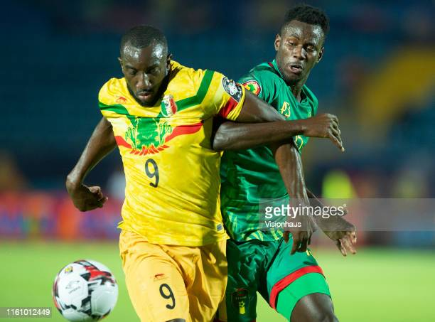 Moussa Marega of Mali and Aly Abeid of Mauritania during the 2019 Africa Cup of Nations Group E match between Mali and Mauritania at Suez Stadium on...
