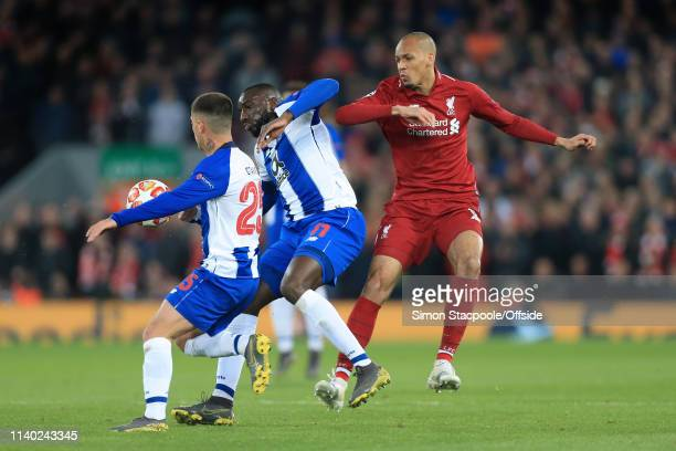 Moussa Marega of Porto battles with Fabinho of Liverpool during the UEFA Champions League Quarter Final first leg match between Liverpool and Porto...