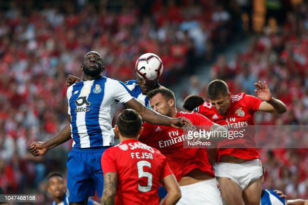 Moussa Marega of Porto heads for the ball with during the Portuguese League football match between SL Benfica and FC Porto at Luz Stadium in Lisbon...