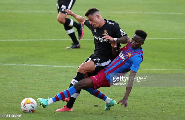 Moussa Ndiaye and Pol during the friendly match between FC Barcelona and Club Gimnastic de Tarragona, played at the Johan Cruyff Stadium on 21th July...