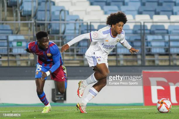Moussa Ndiaye of FC Barcelona B and Peter Gonzalez of Real Madrid Castilla in action during Primera RFEF Group 2 football match played between Real...