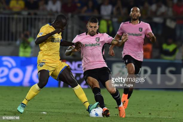 Moussa Saib Kone' of Frosinone and Aleksandar Trajkovski of Palermo compete for the ball during the serie B playoff match final between Frosinone...