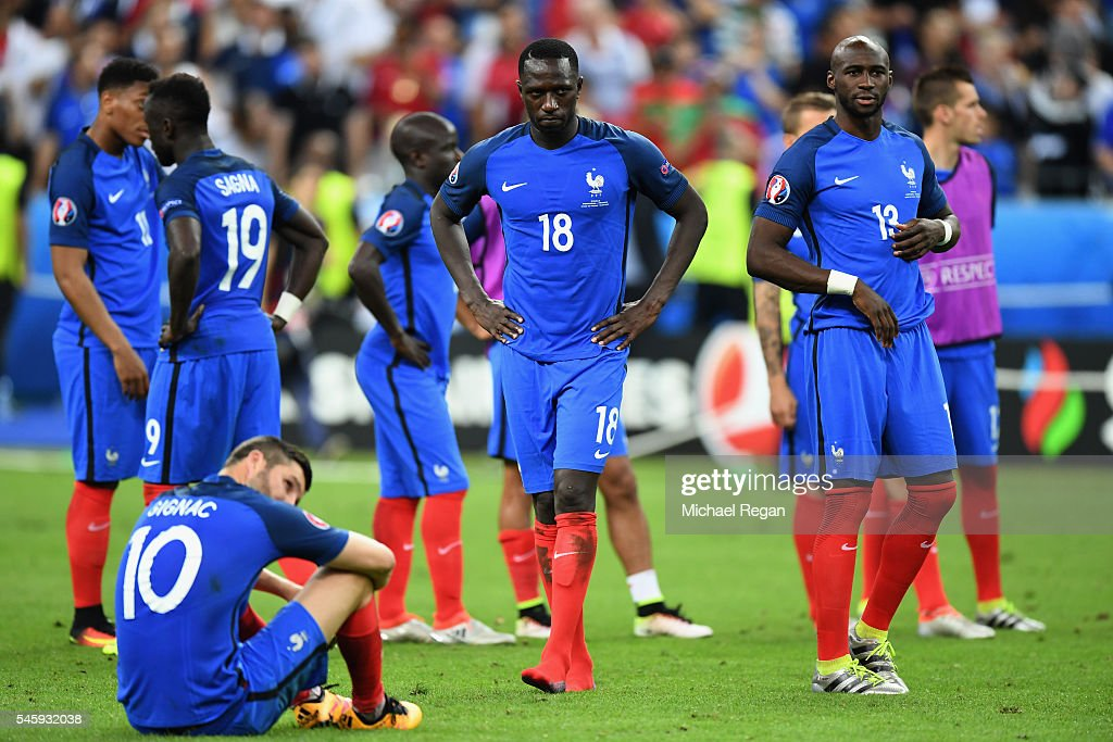 Moussa Sissoko (C) and France shows their dejection after their 0-1 defeat in the UEFA EURO 2016 Final match between Portugal and France at Stade de France on July 10, 2016 in Paris, France.