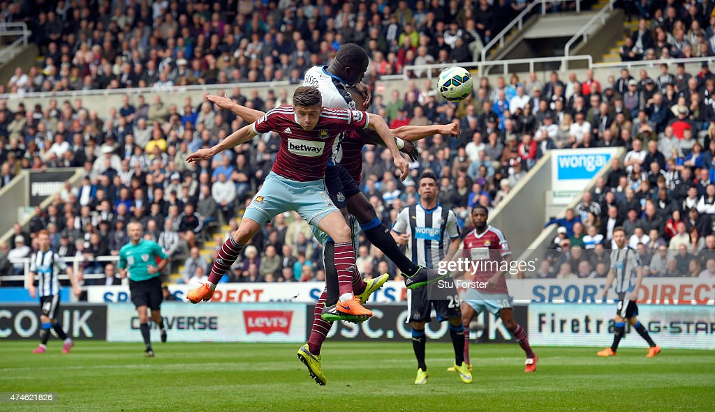 Moussa Sissoko (c) heads the opening goal for Newcastle during the Barclays Premier League match between Newcastle United and West Ham United at St James' Park on May 24, 2015 in Newcastle upon Tyne, England.