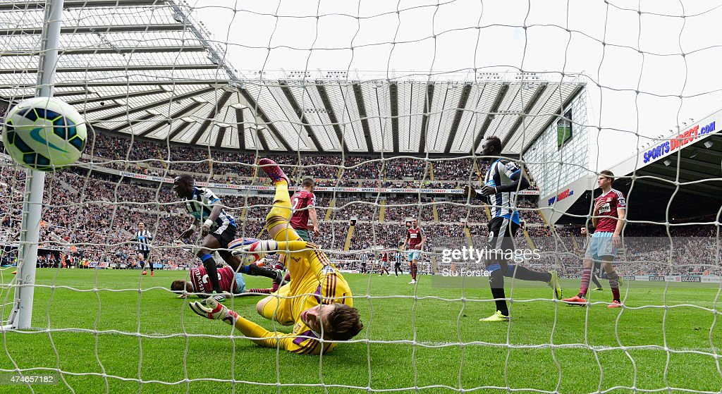 Moussa Sissoko heads the opening goal for Newcastle past Adrian of West Ham during the Barclays Premier League match between Newcastle United and West Ham United at St James' Park on May 24, 2015 in Newcastle upon Tyne, England.