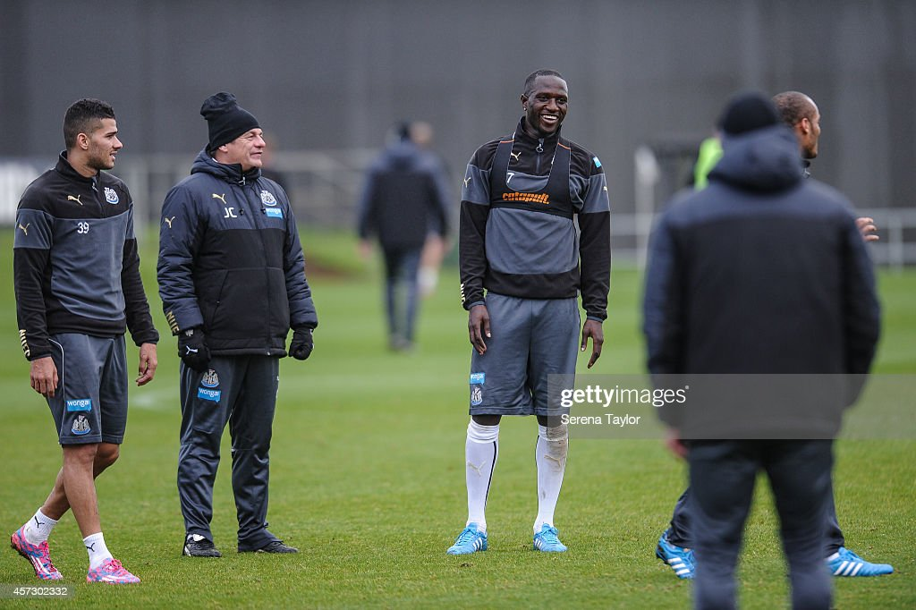 Moussa Sissoko (C) laughs with Assistant Manager John Carver (2L) and Mehdi Abeid (L) during a training session at The Newcastle United Training Centre on October 16, 2014, in Newcastle upon Tyne, England.