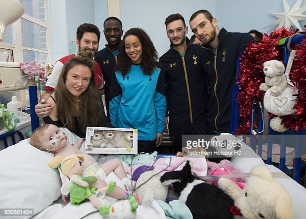 Moussa Sissoko Leah Rawle Hugo Lloris and Pau Lopez of Tottenham Hotspur hand out presents to patients at Whipps Cross Hospital on December 21 2016...