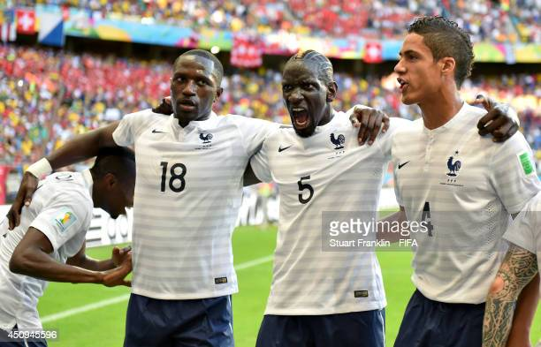 Moussa Sissoko, Mamadou Sakho and Raphael Varane of France celebrate their team's second goal by Blaise Matuidi during the 2014 FIFA World Cup Brazil...