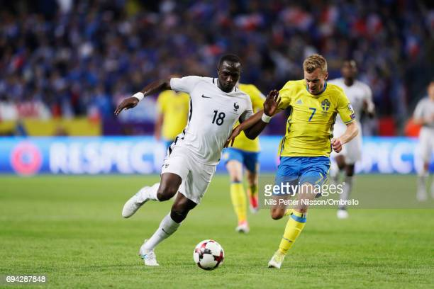 Moussa Sissoko of France and Sebastian Larsson of Sweden competes for the ball during the FIFA 2018 World Cup Qualifier between Sweden and France at...