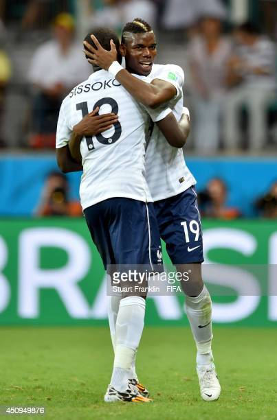 Moussa Sissoko of France celebrates scoring his team's fifth goal with his teammate Paul Pogba during the 2014 FIFA World Cup Brazil Group E match...
