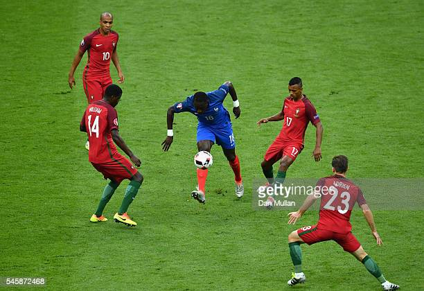 Moussa Sissoko of France controls the ball under pressure of Portugal playes during the UEFA EURO 2016 Final match between Portugal and France at...